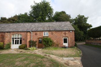 BURTON HALL BARNS, BURTON - 2 bedroom barn conversion